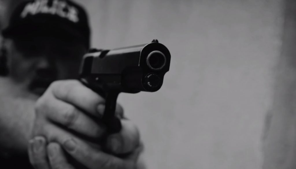 "still from ""Alright"" depicting corruption within police forces"